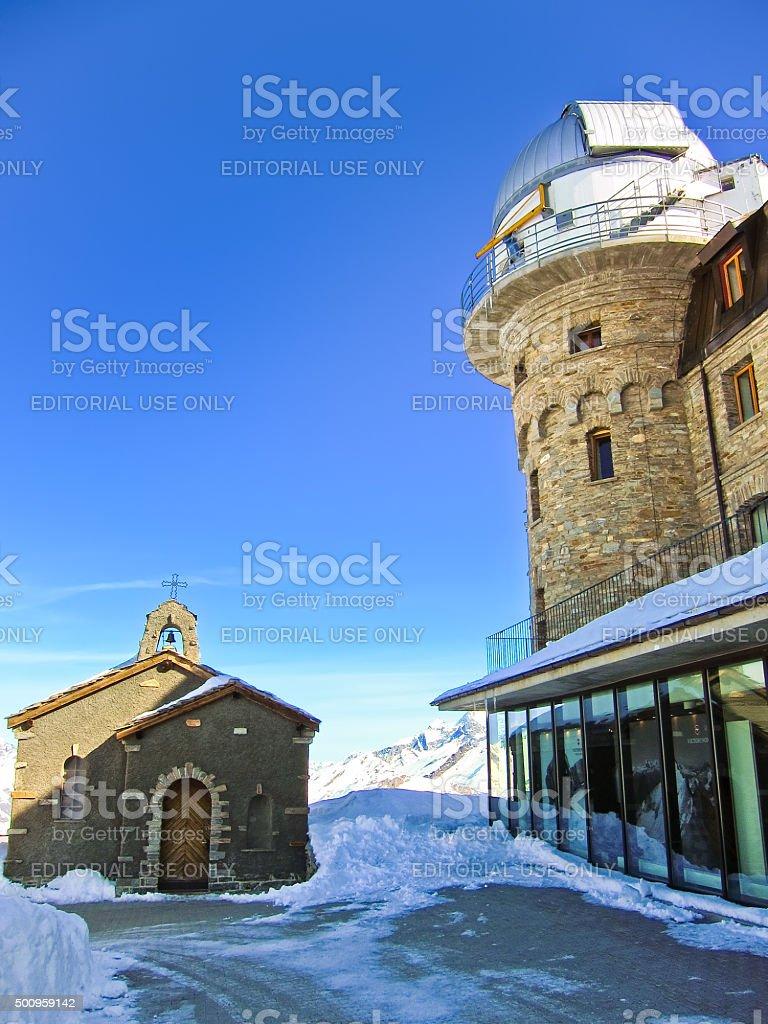 Gornergrat Kulm Hotel and a chapel in Gornergrat, Zermatt, Switzerland stock photo
