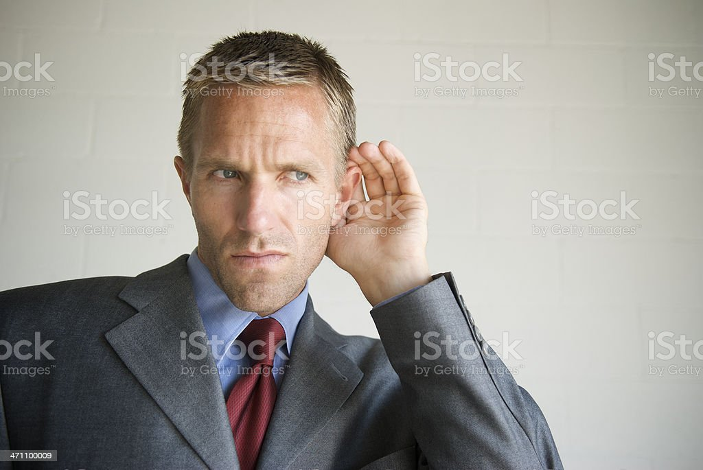 Gossip Businessman Cupping his Ear Listening to White Copy Space royalty-free stock photo