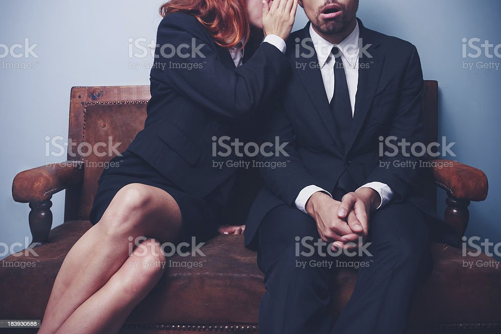 Gossip in the office lobby stock photo