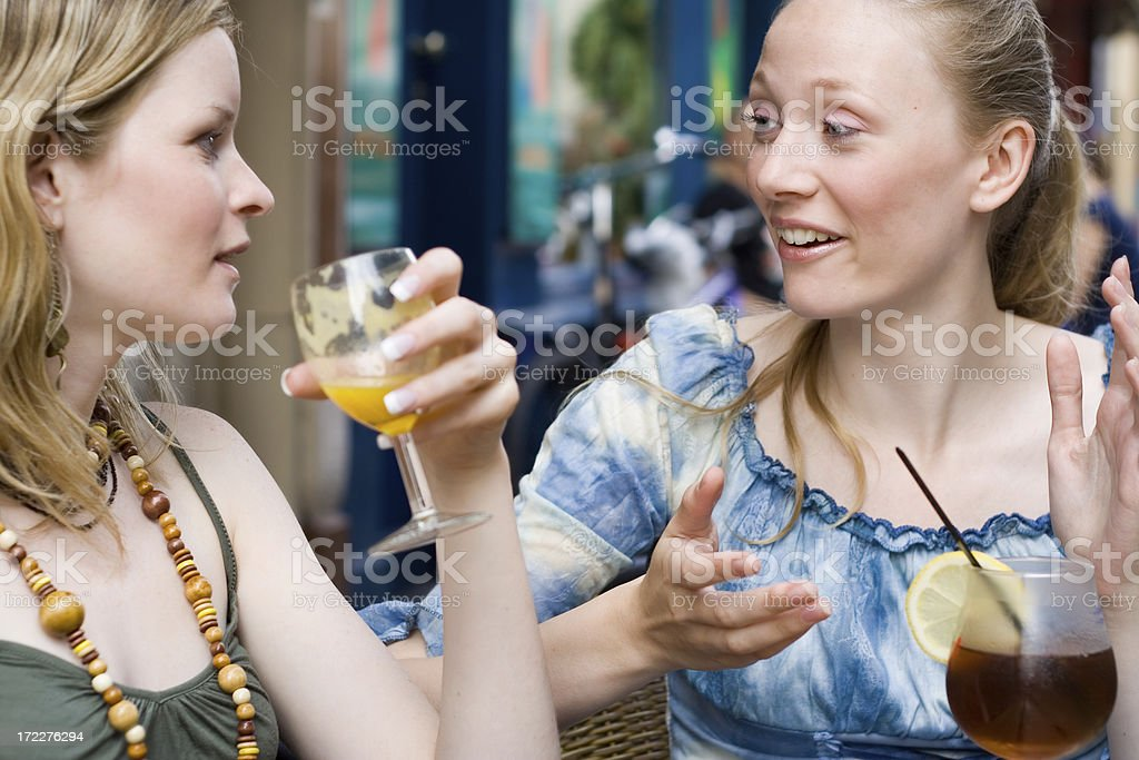 Gossiping at coffee shop outdoors royalty-free stock photo