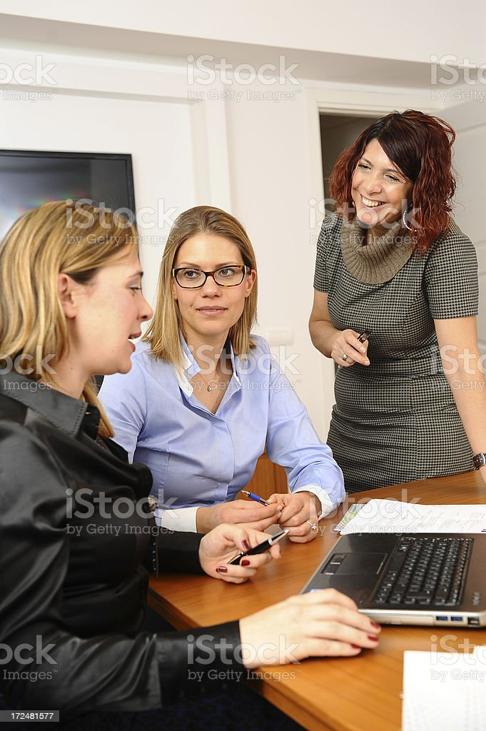 Gossiping at the office royalty-free stock photo