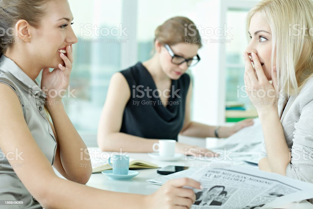 Gossiping in office stock photo