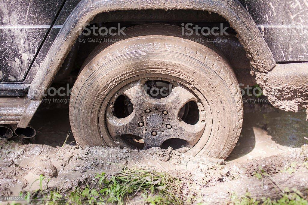 SUV got stuck in the mud, wheel closeup stock photo