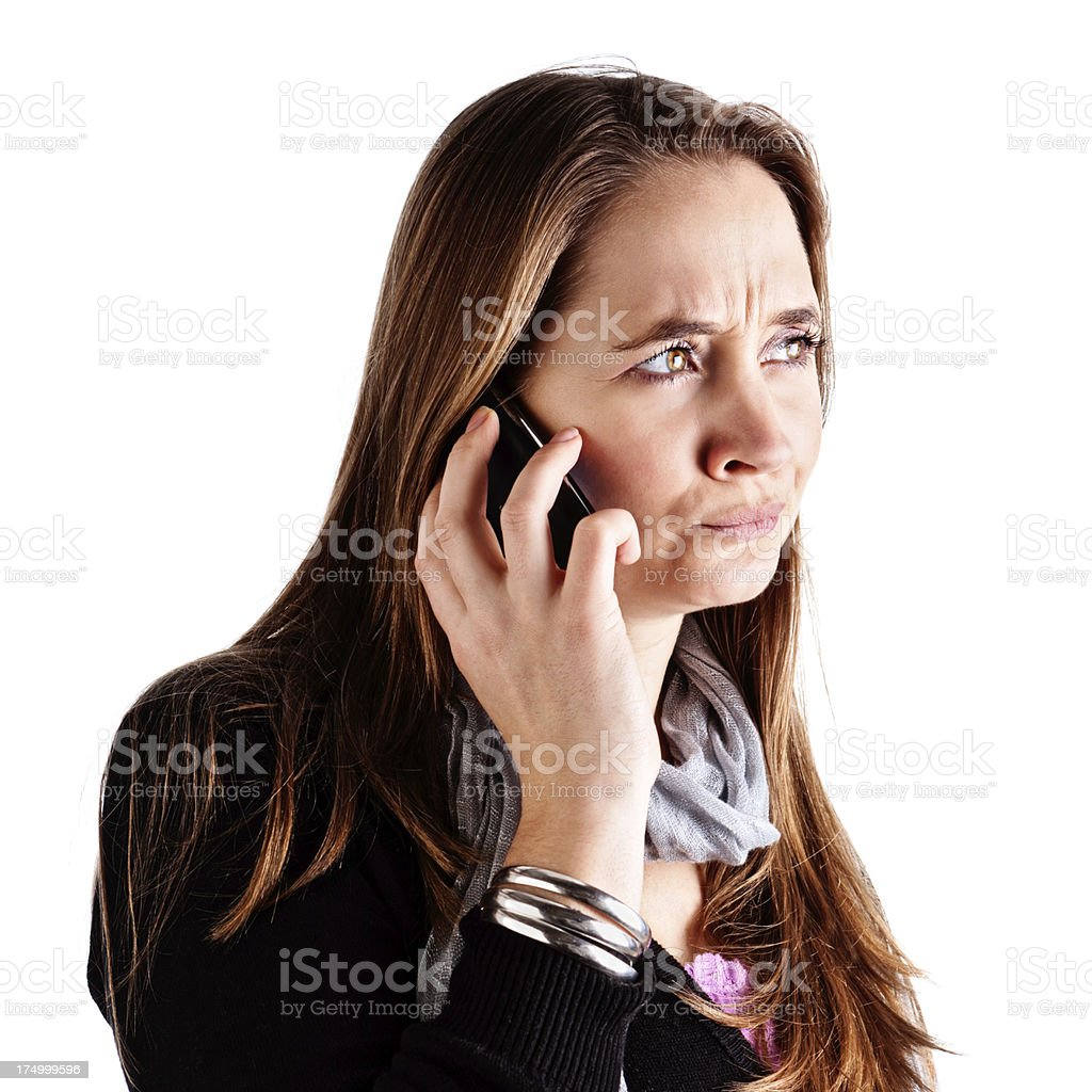 Got the callcenter! Frowning woman using cell phone is frustrated stock photo