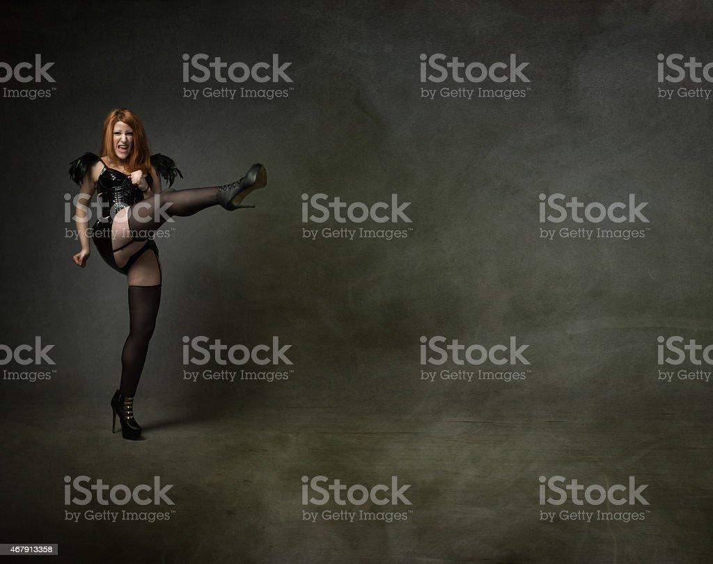 goth girl aggressive kick stock photo