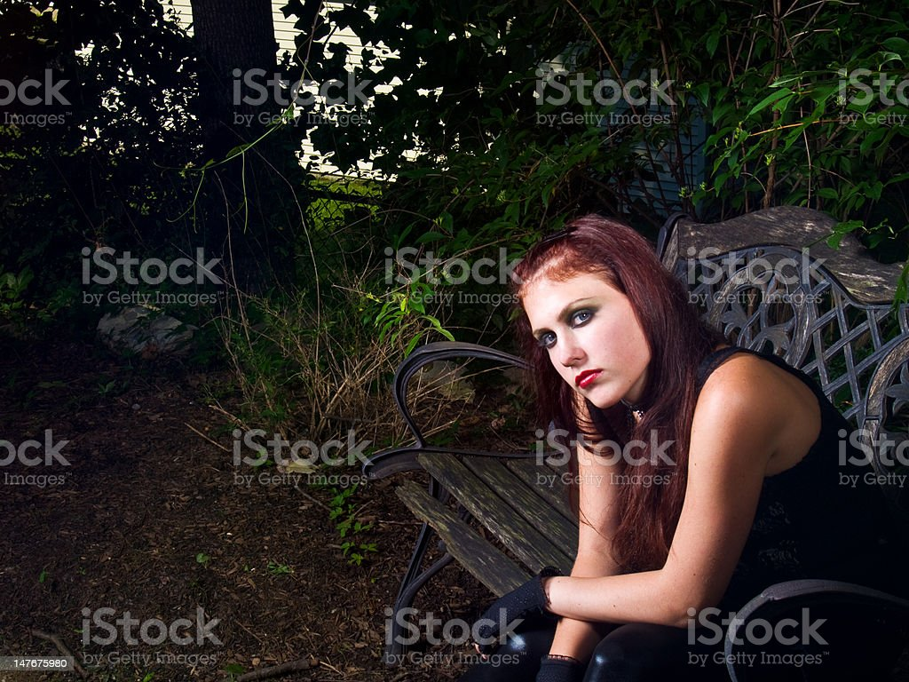 Goth Girl on Bench stock photo