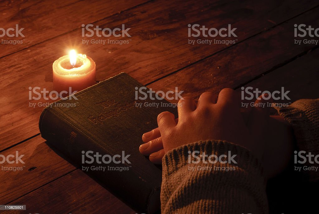 Gothic bible at candle light royalty-free stock photo