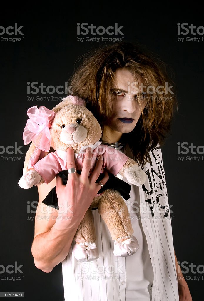 Gothic boy with a plush toy royalty-free stock photo