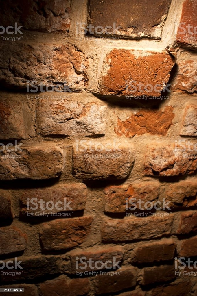 Gothic brick wall inside the dungeon. stock photo