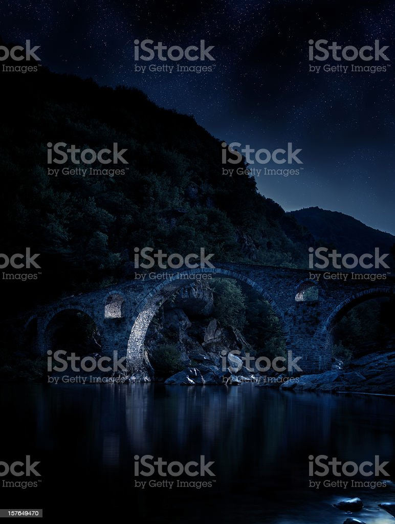 Gothic bridge over river in the night royalty-free stock photo