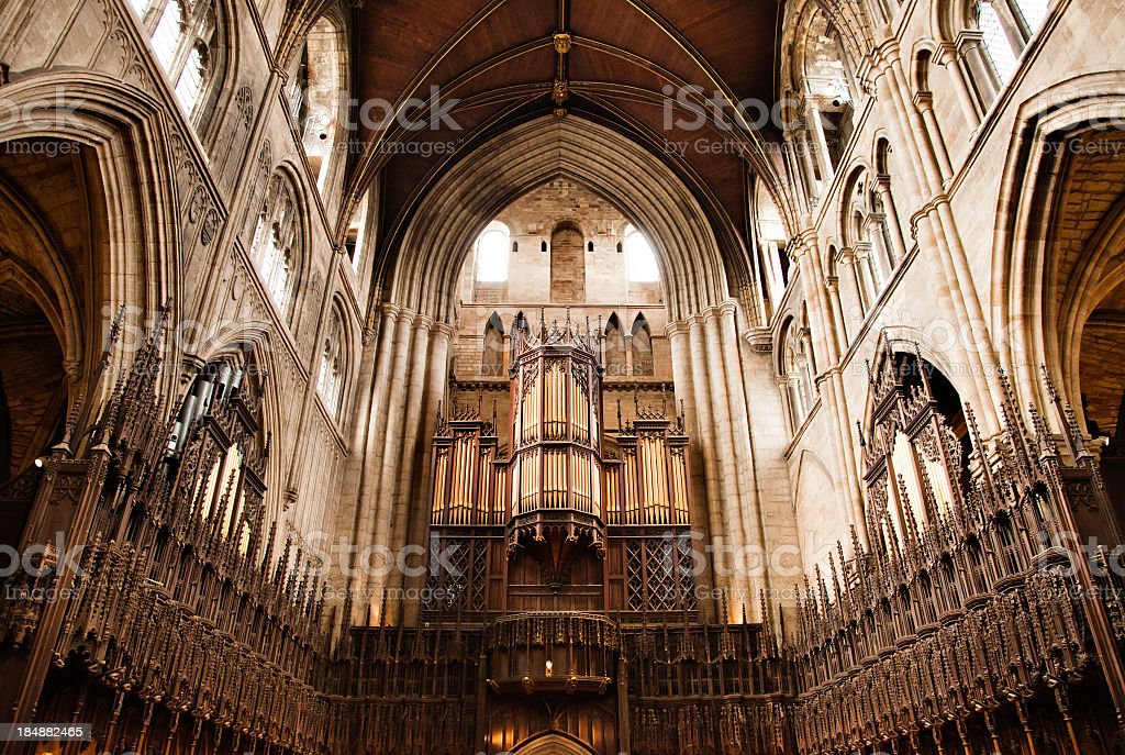 Gothic cathedral apse with pipe organ stock photo