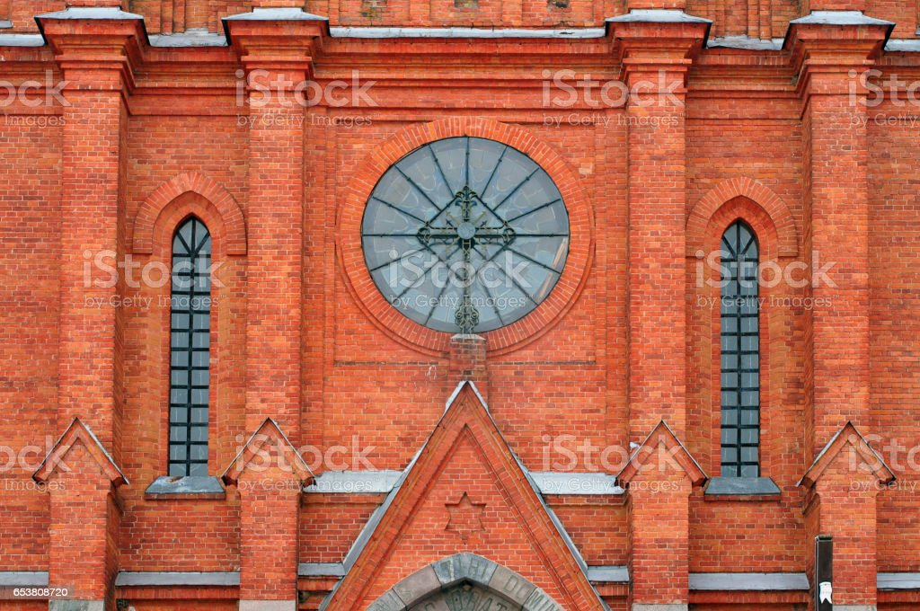 Gothic Church of the Holy Apostles Peter and Paul of red brick in the village Old Vasilishki, Grodno region, Belarus. stock photo