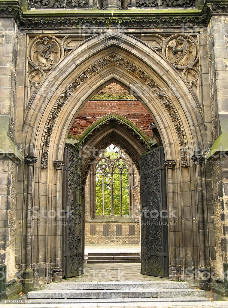 The entrance of an old gothic cathedral. Frontal view.
