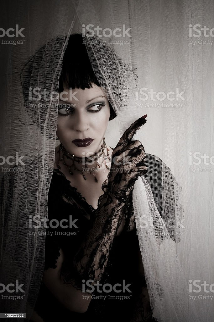 Gothic Girl Wearing Black Lace Gloves stock photo