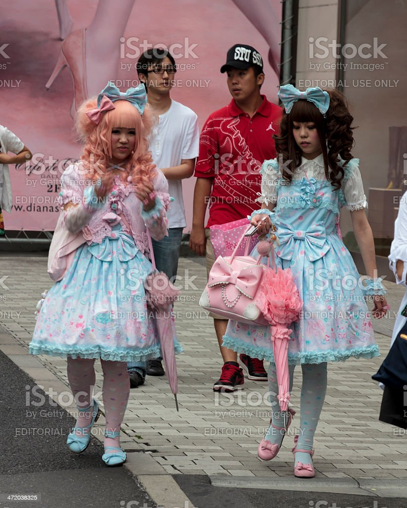 Gothic lolitas walking in the street stock photo