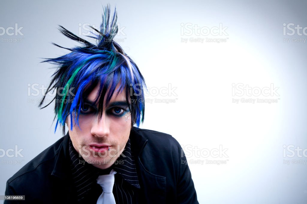 Gothic punk styled man posing for a portrait stock photo
