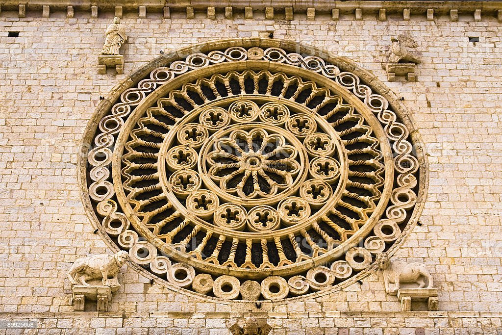 Gothic rose window with sculptures of evangelists' symbols royalty-free stock photo