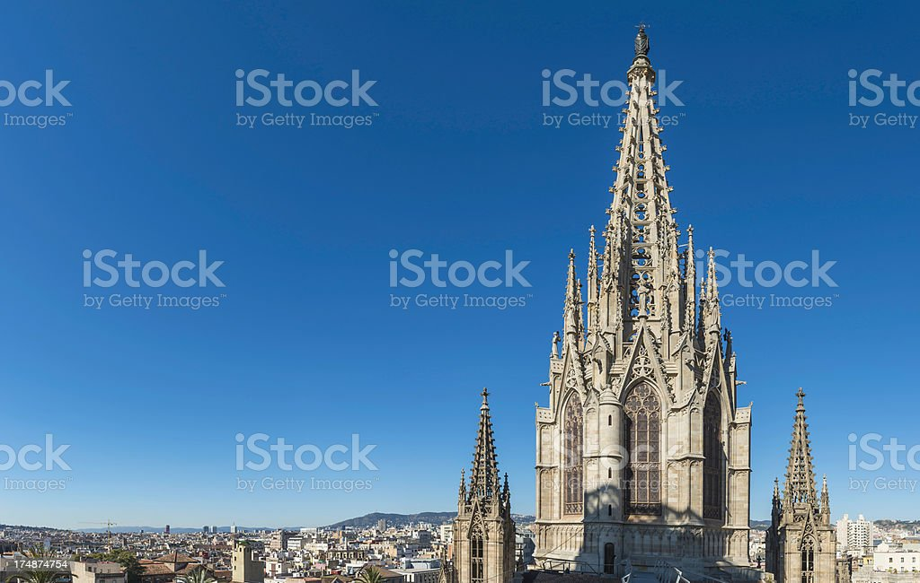 Gothic spire soaring into blue skies Barcelona Cathedral Spain stock photo