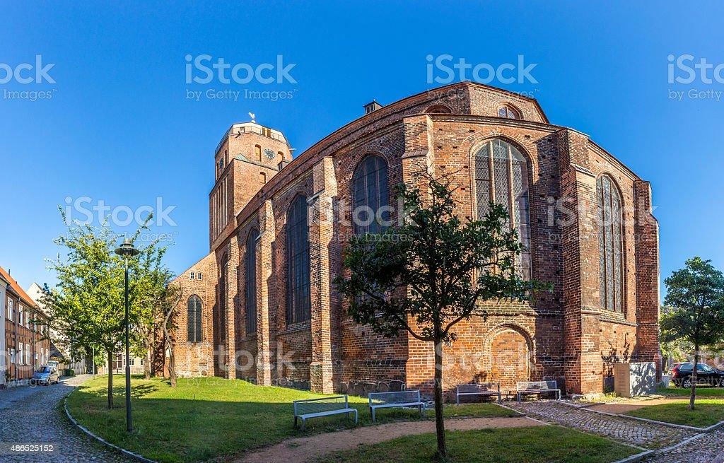 gothic St Petri church in Wolgast under blue sky stock photo