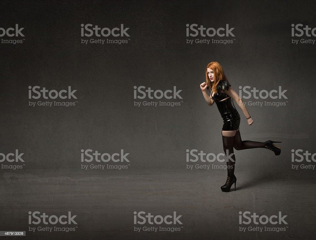 gothic woman running stock photo