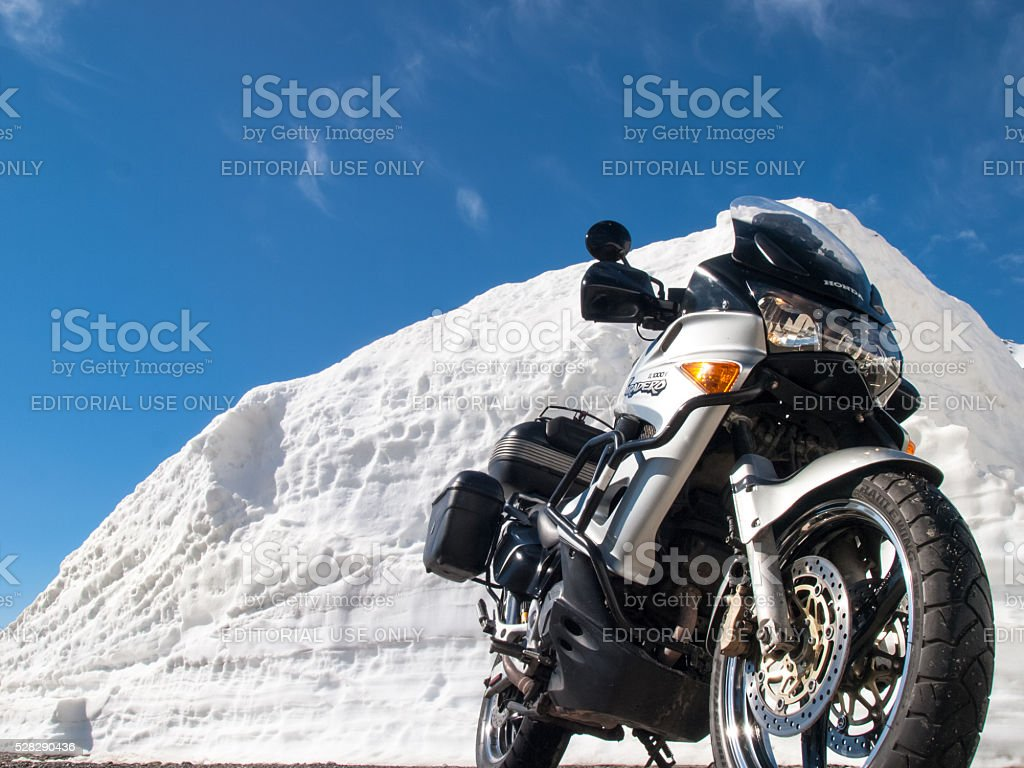 Gotthardpass, vehicles in transit between the walls of snow stock photo