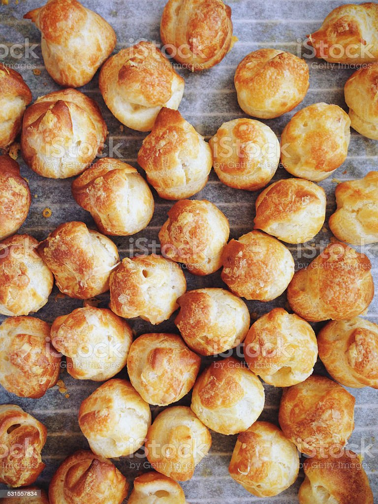 Gougères hot French cheese puff stock photo