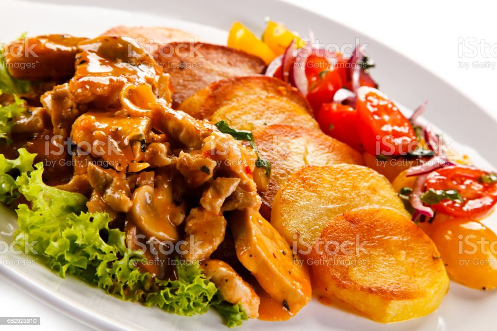 Goulash with baked potatoes and vegetables stock photo