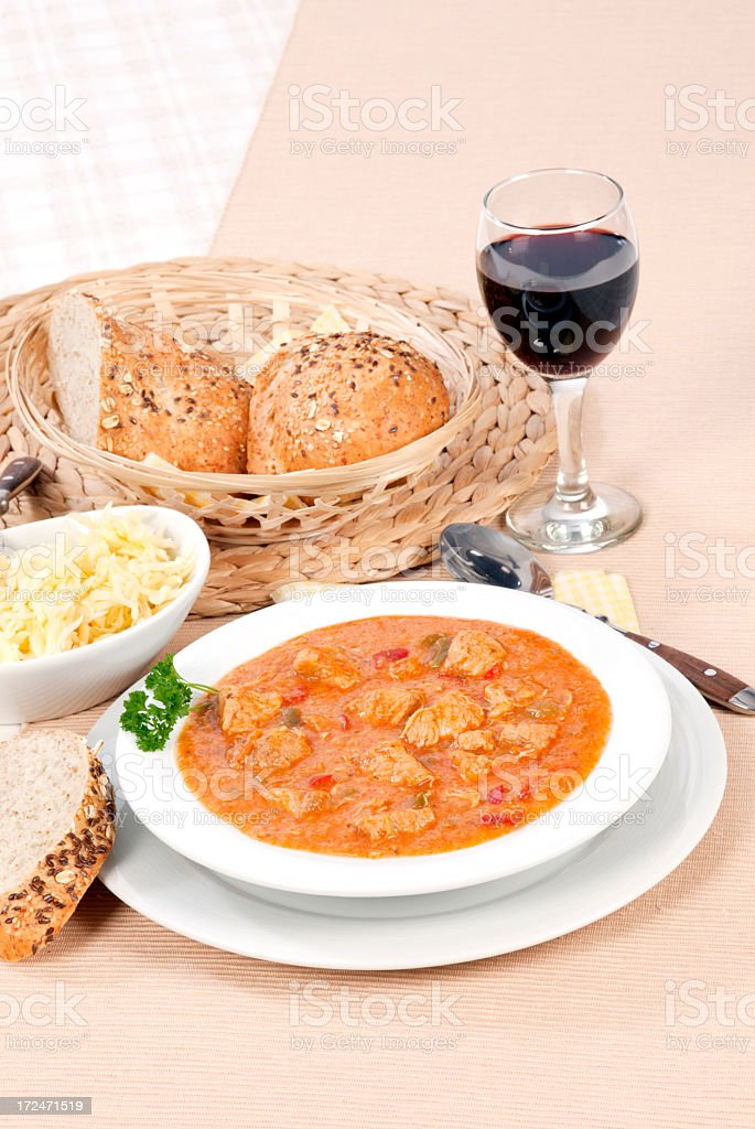 Goulash with bread and wine royalty-free stock photo