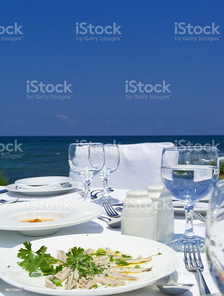 Gourme lunch on mediterranean shore royalty-free stock photo