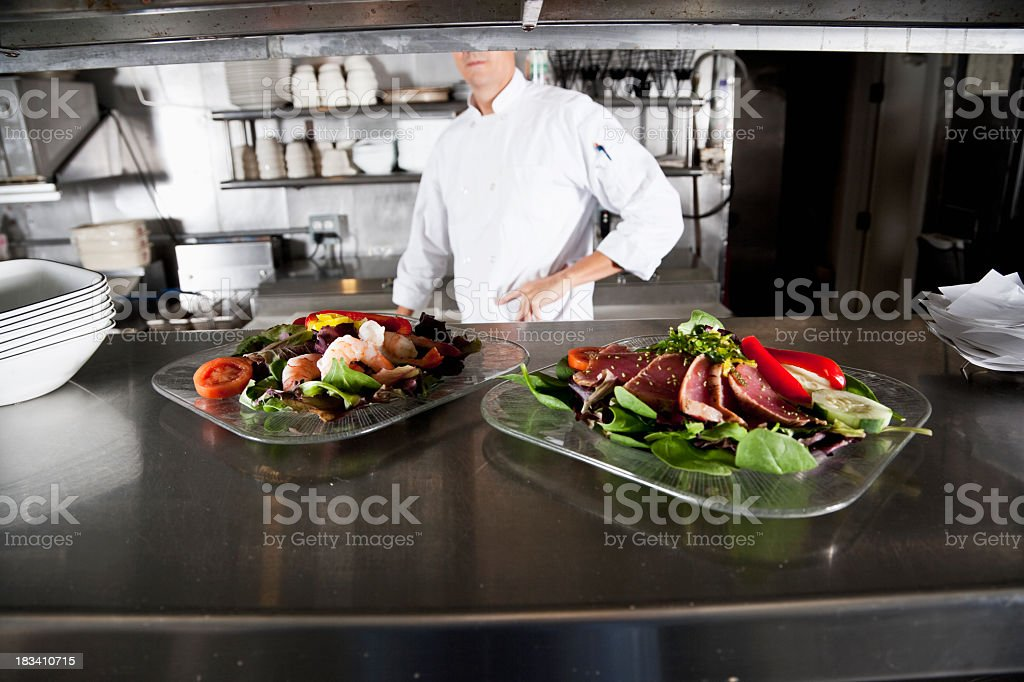 Gourmet appetizers in commercial kitchen stock photo