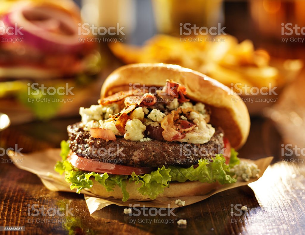 gourmet bacon and blue cheese burger stock photo