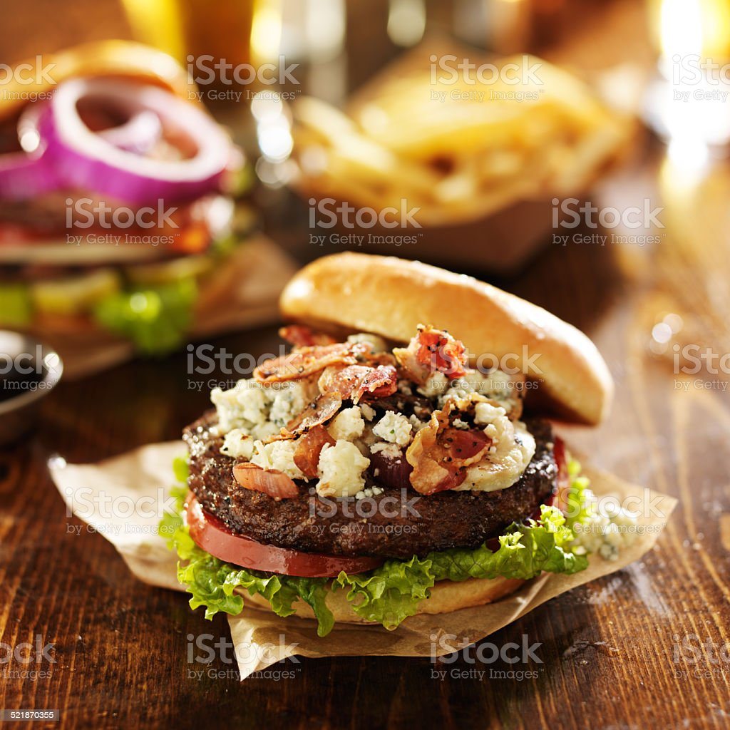 gourmet bacon and blue cheese burgers with beer stock photo