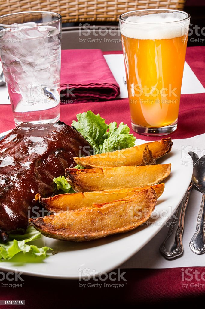 Gourmet Barbeque Ribs, Fries and Beer stock photo