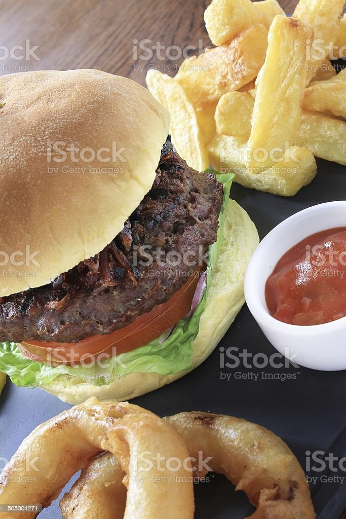 gourmet burger with fries plated meal stock photo