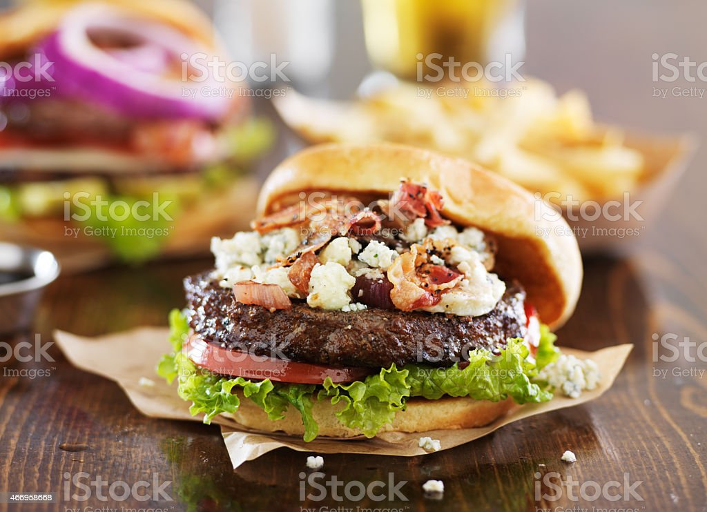 gourmet burgers on wooden table stock photo