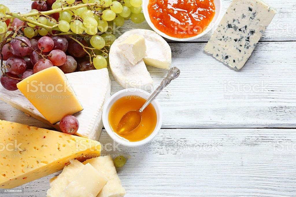 Gourmet cheeses with honey stock photo