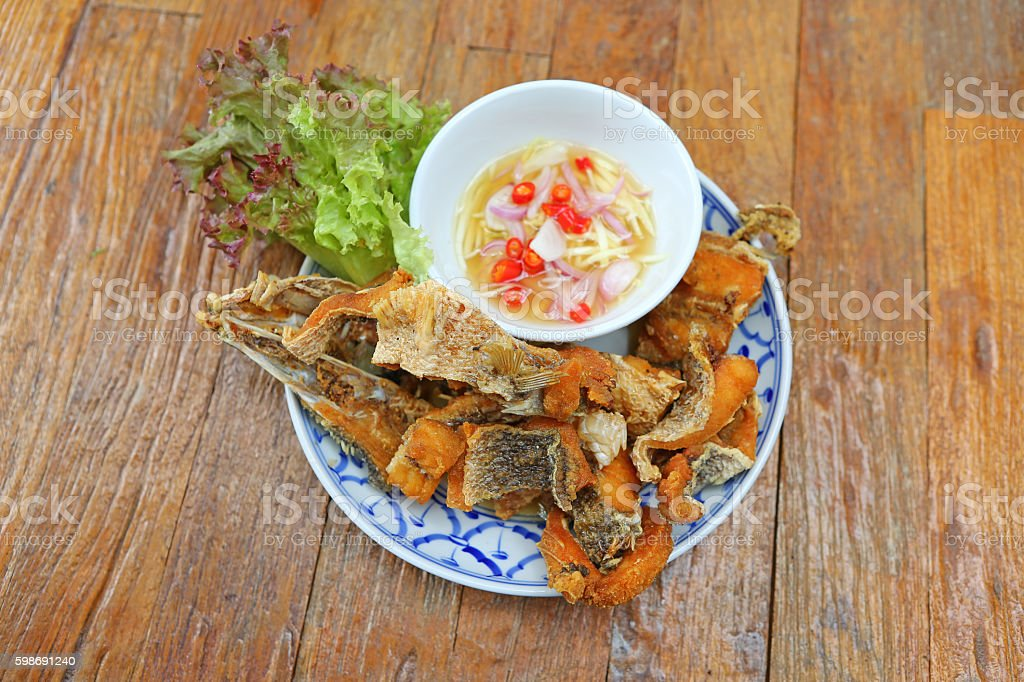 Gourmet chunks of fried Asian style snapper served. stock photo
