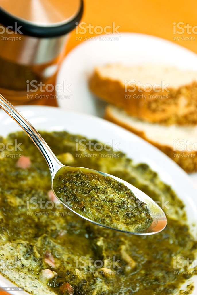 Gourmet Cream Soup With Green Cabbage And Slices Of Ham royalty-free stock photo