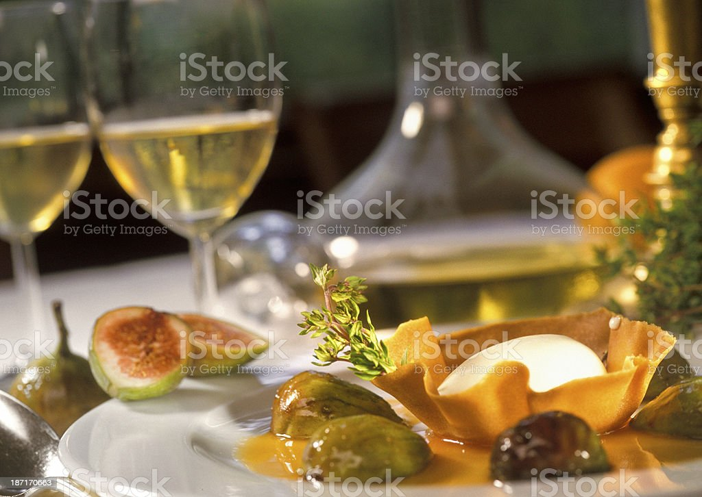 gourmet dessert of vanilla ice cream with roasted figs stock photo