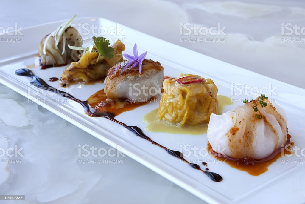 Gourmet Dim Sum on a White Marble Background stock photo