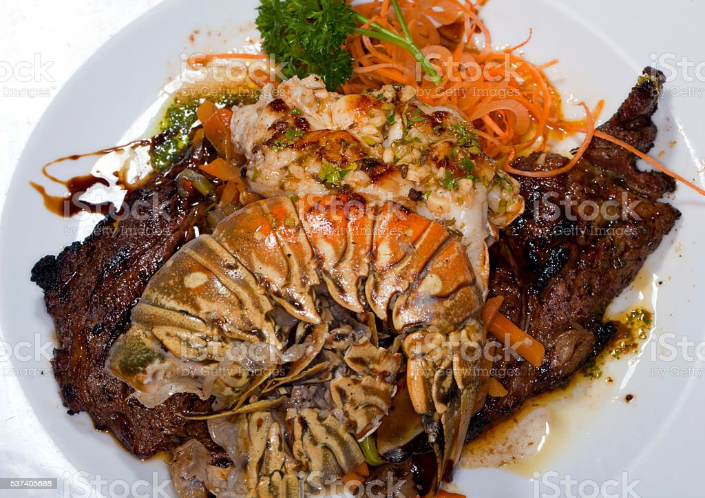 Gourmet Dining: Lobster and Steak stock photo