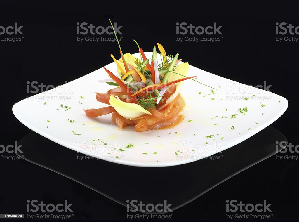 Gourmet dish of smoked salmon and vegetables royalty-free stock photo