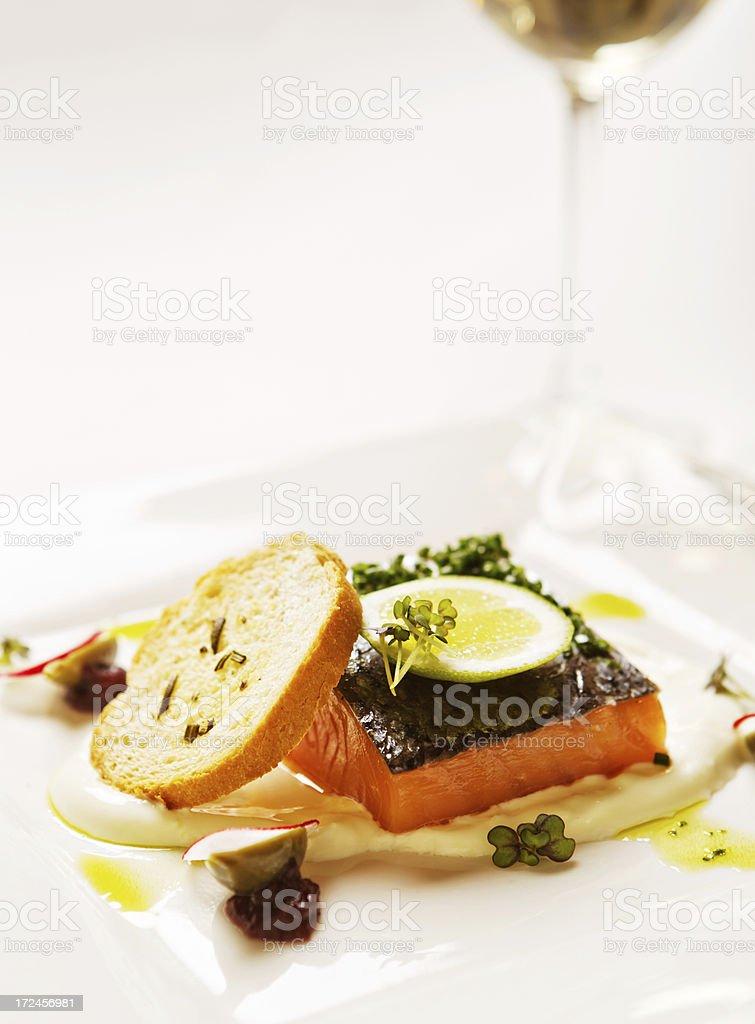 Gourmet feast of fresh salmon with lime yogurt and bruschetta stock photo