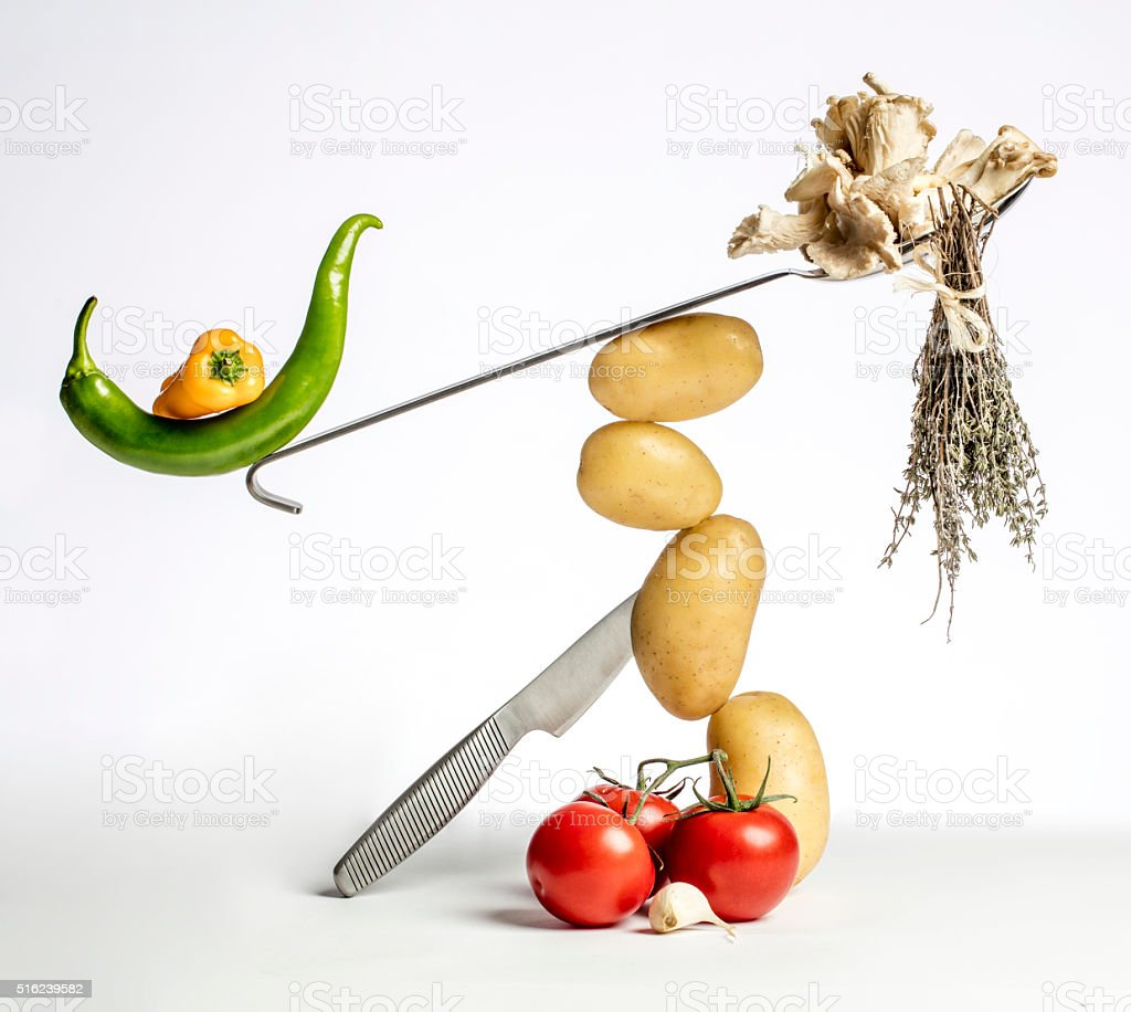 gourmet food composition with colorful vegetables and modern kitchen utensils stock photo