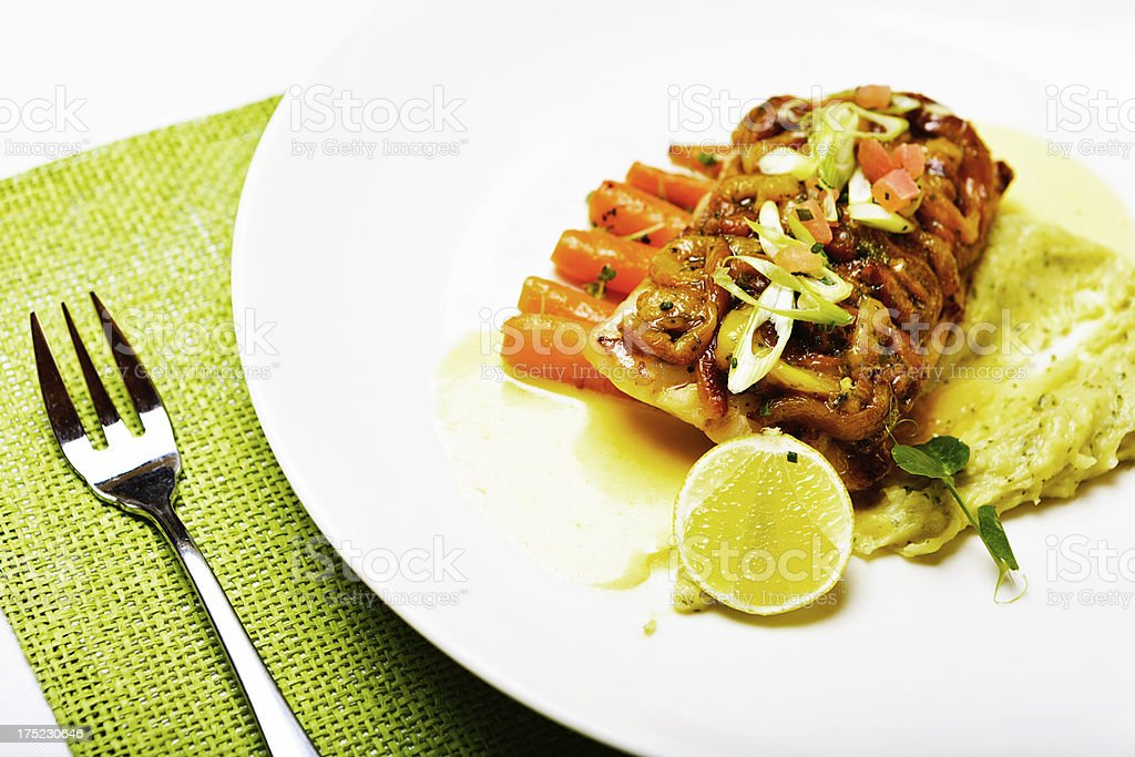 Gourmet grilled fish dish looks delicious royalty-free stock photo