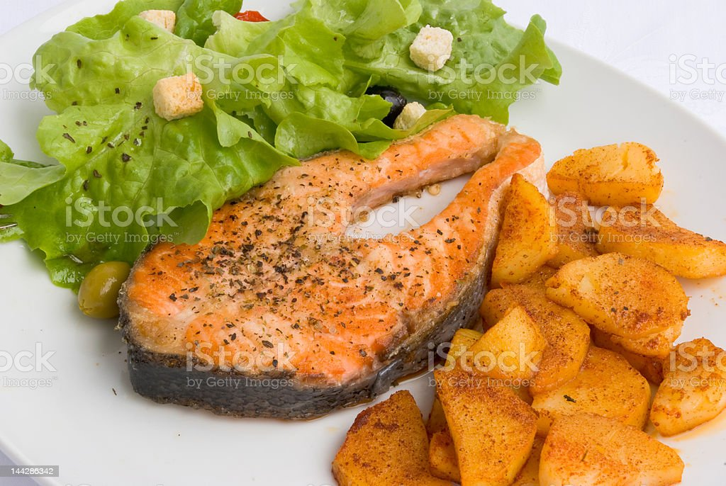 Gourmet grilled Salmon with Herbs-Crust and Salad royalty-free stock photo