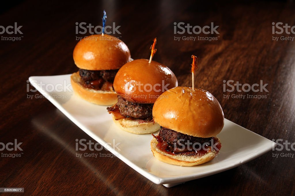 Gourmet hamburger sliders with bacon and copy space stock photo
