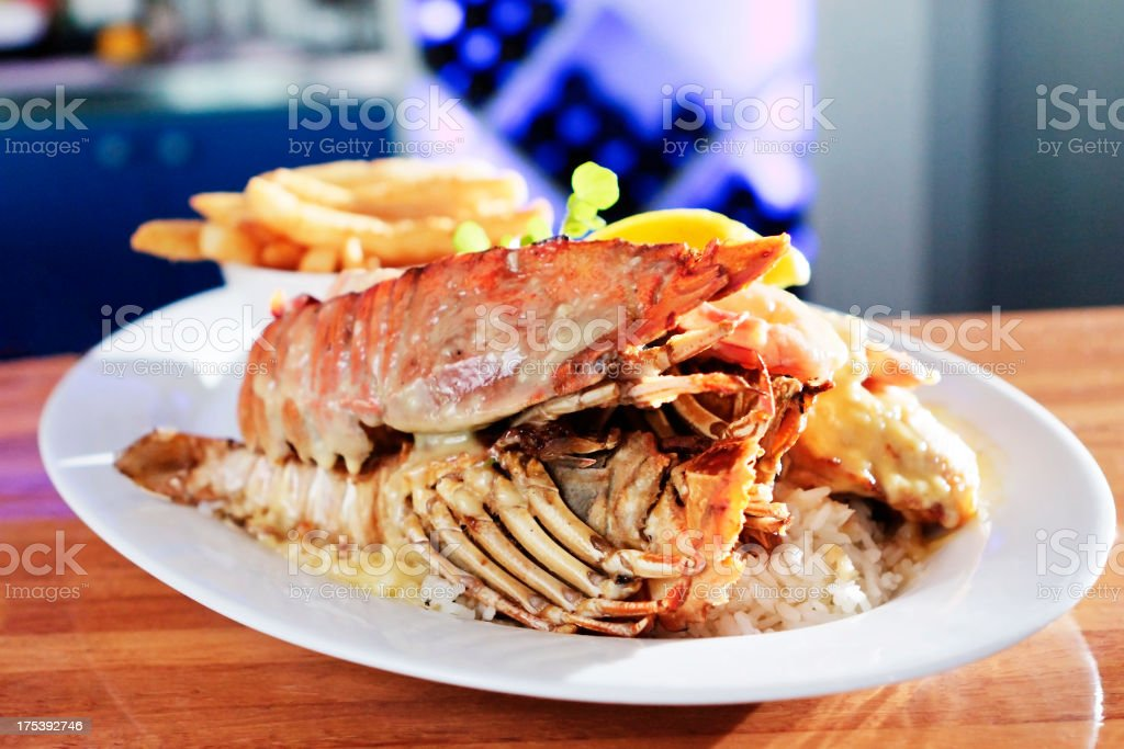 gourmet meal of lobster, prawns, rice and fries royalty-free stock photo