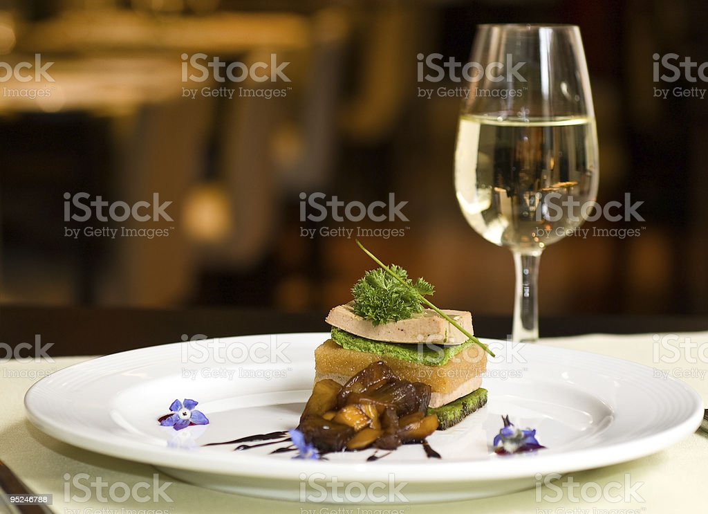 Gourmet meal served with white wine stock photo