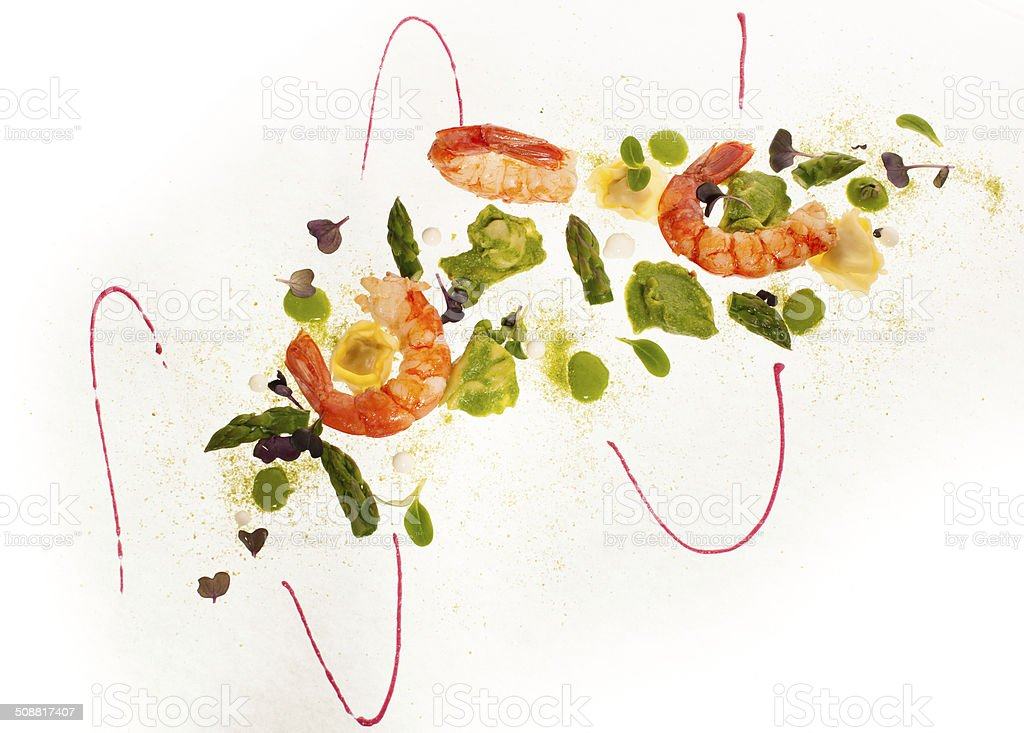 gourmet plate of shrimps with sparagus and ravioli pasta royalty-free stock photo